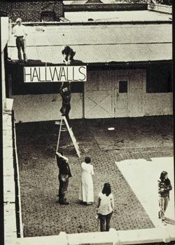 Hallwalls' founders in courtyard of Essex St., 1974